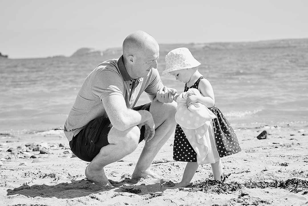 Dad and daughter on a beach