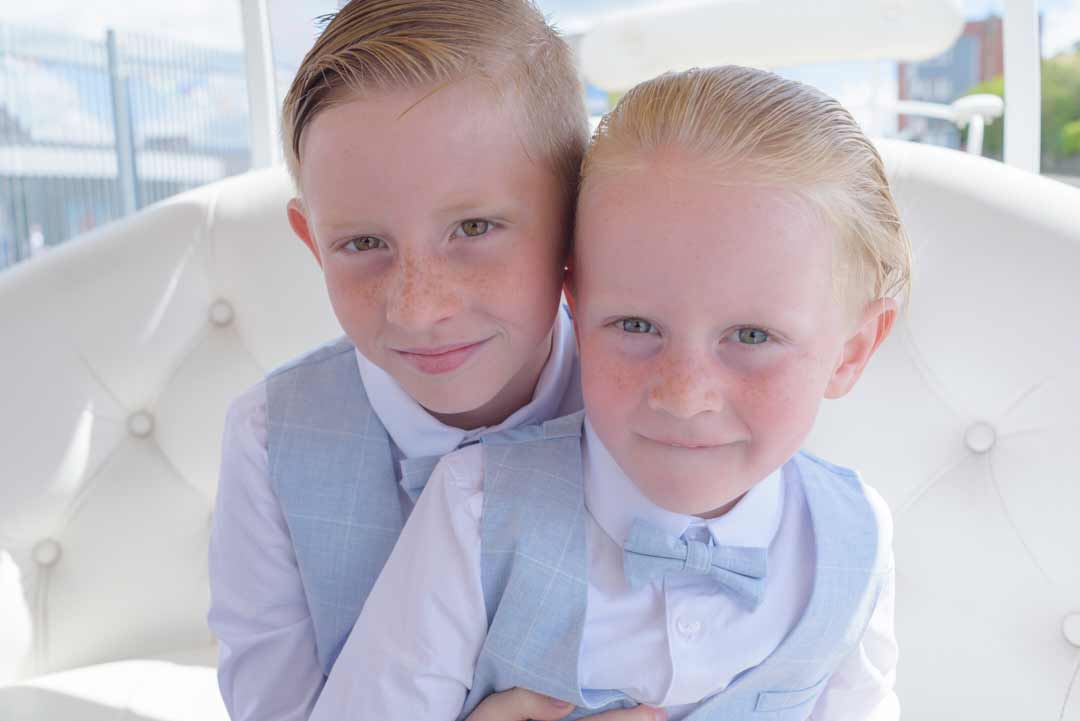 Two boys in identical suits