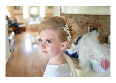 Girl wearing tiara on her communion day