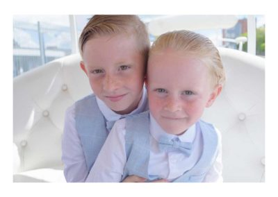 Two kids pose in matching suits