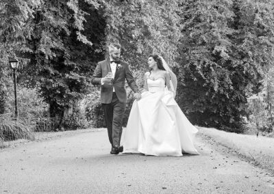 wedding couple walking in Ballyseede Castle Hotel