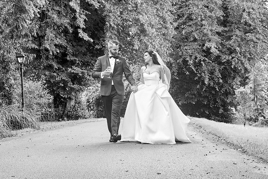 bride and groom walk ballyseede castle